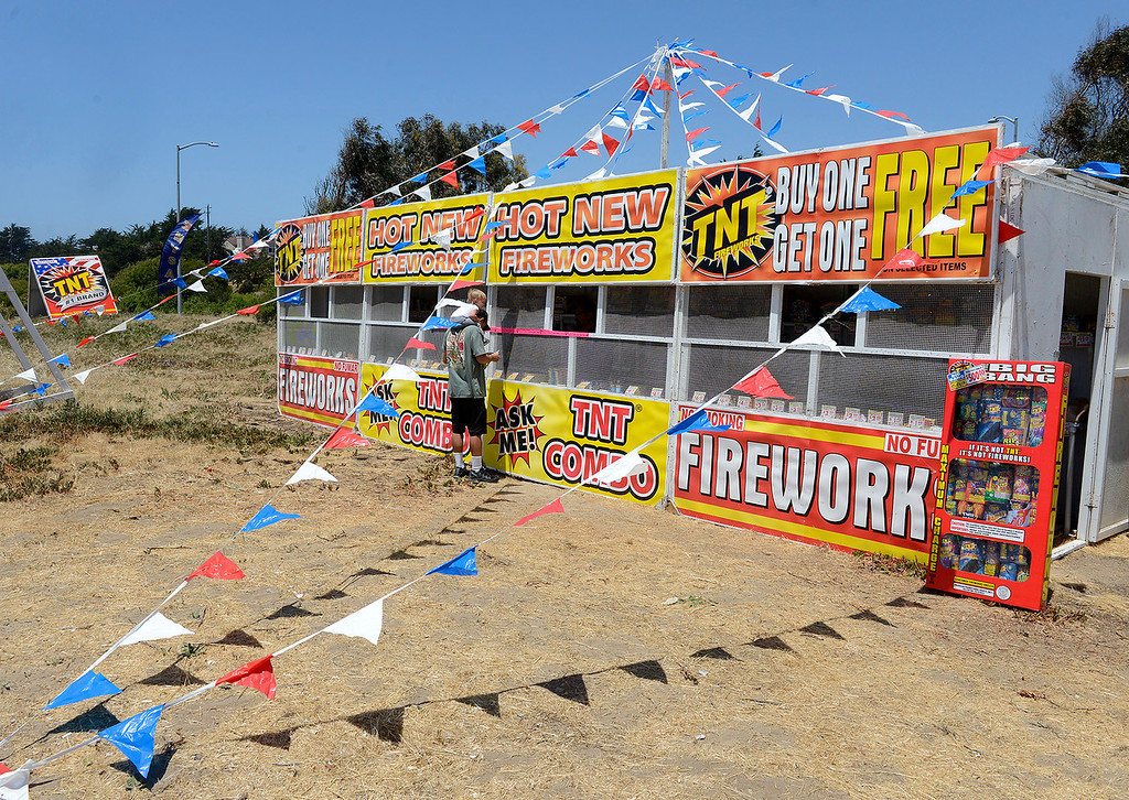 . Daniel Munoz selling Safe and Sane fireworks in Marina on Friday, June 29, 2018.  (Vern Fisher - Monterey Herald)
