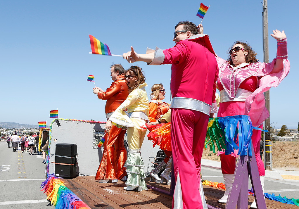 ". Mama Mia cast Members from the Pacific Repertory Theater sing Abba\'s ""Mama Mia\"" as hey ride down on a flatbed truck during the Monterey Peninsula Pride Parade in Seaside on Saturday June 30, 2018. (David Royal/ Herald Correspondent)"