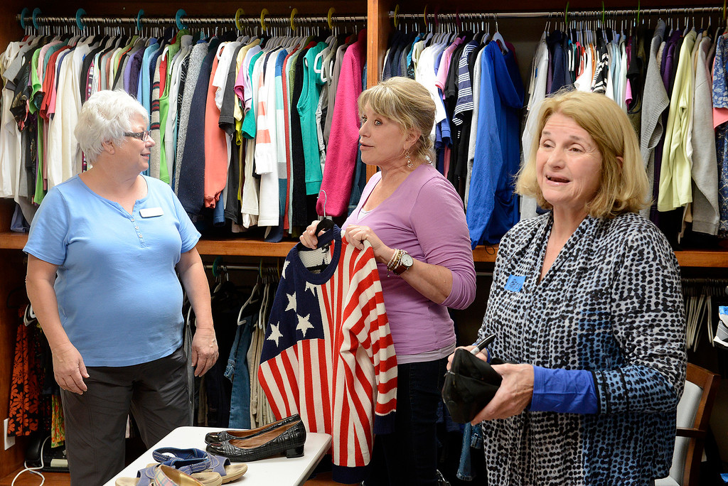 . Volunteers Becky Pearson, Margaret Pelikan and Betsy Pratt work in the clothes closet at the non-profit Gathering for Women in Monterey on Tuesday, July 3, 2018.  The Gathering for Women has opened its permanent day center in Monterey, a $2.5 million project that now has a paid staff and includes both health and transitional programming along with serving breakfast and lunch every day to the women it serves.  (Vern Fisher - Monterey Herald)