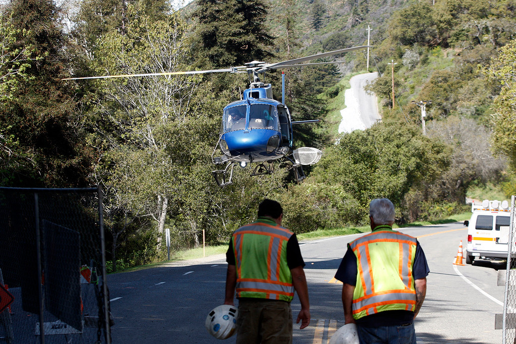 . A helicopter prepares to shuttle work crews to the south side of the Pfeiffer Canyon Bridge as progress was being made on the demolition of the storm damaged Pfeiffer Canyon Bridge in Big Sur on Thursday, March 16, 2017.  (Vern Fisher - Monterey Herald)