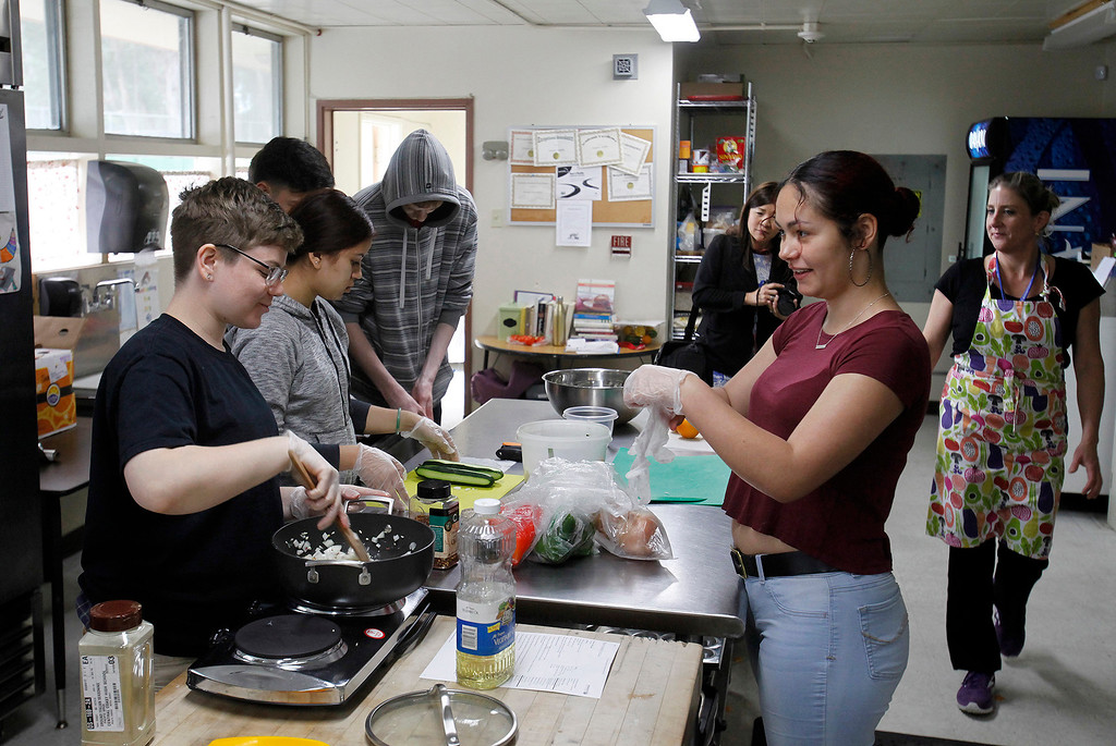 . Central Coast High School students Ella Winter and Madison Lewis work in the culinary academy kitchen in Seaside with chef Kari Bernardi on Wednesday, March 15, 2017.  (Vern Fisher - Monterey Herald)