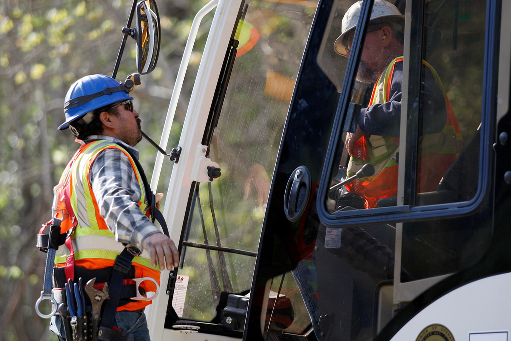 . Crane operators confer during the demolition of the storm damaged Pfeiffer Canyon Bridge in Big Sur on Thursday, March 16, 2017.  (Vern Fisher - Monterey Herald)