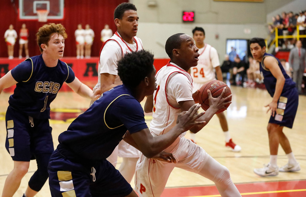 . Palma\'s Jamaree Bouyea (4) drives to the basket against Central Catholic during a boys basketball NorCal Division IV Regional Semifinals game at Palma High School on Tuesday, Mar. 14, 2017 in Salinas, Calif. (Vernon McKnight/Herald Correspondent)