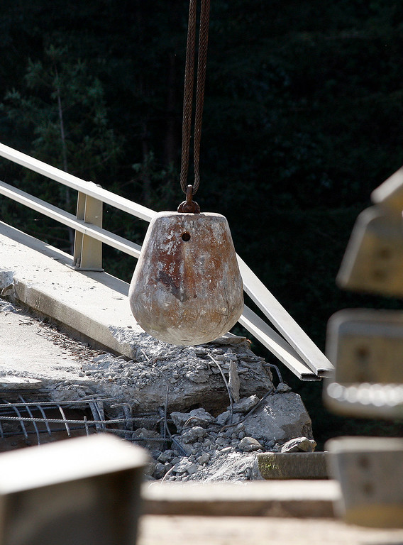 . Crews use a 6,000 pound wrecking ball attached to a crane on the demolition of the storm damaged Pfeiffer Canyon Bridge in Big Sur on Thursday, March 16, 2017.  (Vern Fisher - Monterey Herald)