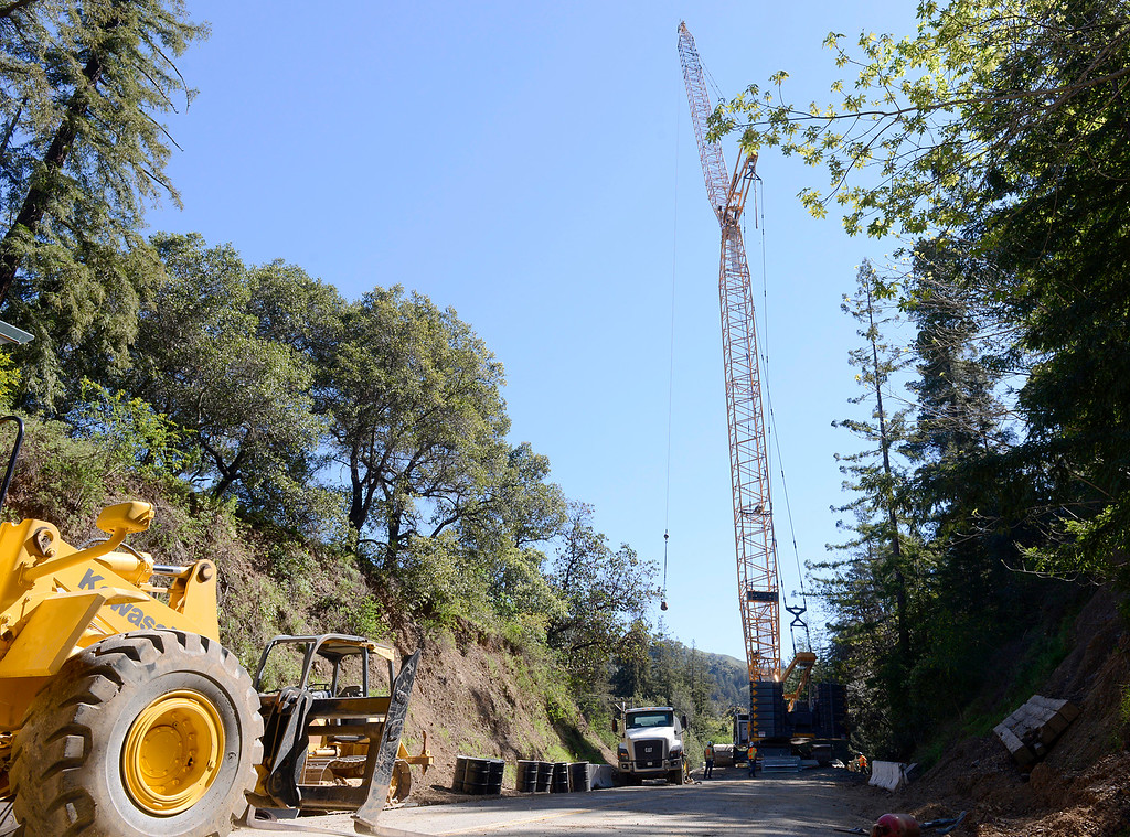 . Construction crews use a wrecking ball to dismantle the Pfeiffer Canyon Bridge on Highway 1 in Big Sur, Calif. on Monday March 13, 2017. The bridge was compromised after slides occurred in the area associated with this winter\'s heavy rains.  (David Royal - Monterey Herald)