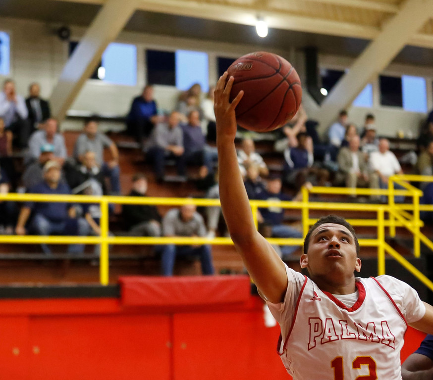 . Palma\'s Cameron Jones (12) reaches for a pass against Central Catholic during a boys basketball NorCal Division IV Regional Semifinals game at Palma High School on Tuesday, Mar. 14, 2017 in Salinas, Calif. (Vernon McKnight/Herald Correspondent)