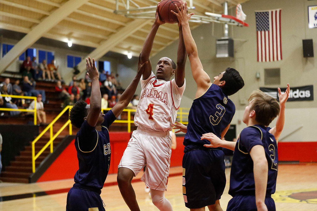 . Palma\'s Jamaree Bouyea (4) shoots the ball against Central Catholic\'s Daron Bland (5), left, Amrit Dhaliwal (3), center, and Cooper Wilson (2) during a boys basketball NorCal Division IV Regional Semifinals game at Palma High School on Tuesday, Mar. 14, 2017 in Salinas, Calif. (Vernon McKnight/Herald Correspondent)