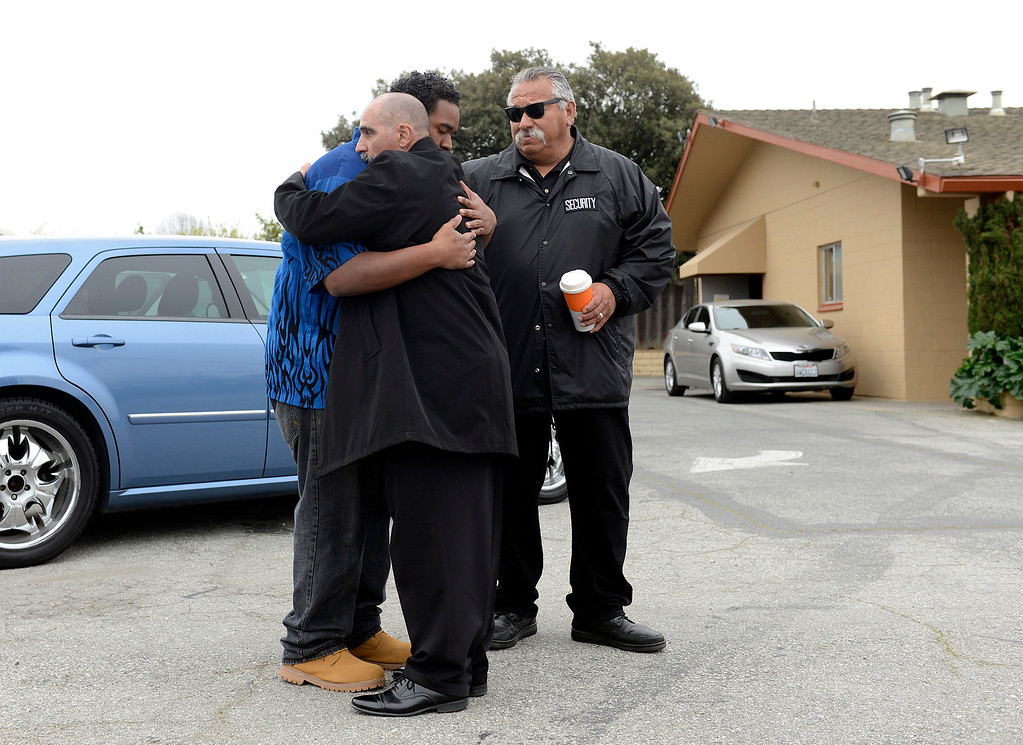 . Cesar Blakeney, left, is embraced by Brother Robert Libardo and Brother George Espinosa during a gathering for Pastor Herbert Valero at Victory Outreach Church in Salinas on Wednesday March 15, 2017. Valero was stabbed in the neck outside of his home after a going out to pray with a parishioner on Tuesday evening.  (David Royal - Monterey Herald)