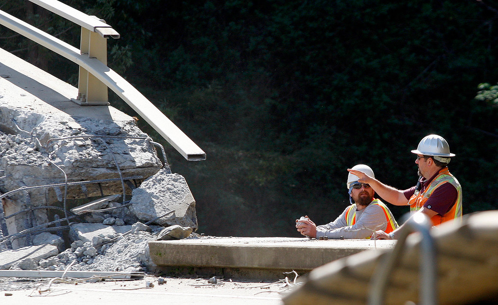 . Inspectors check on the progress of the demolition of the storm damaged Pfeiffer Canyon Bridge in Big Sur on Thursday, March 16, 2017.  (Vern Fisher - Monterey Herald)