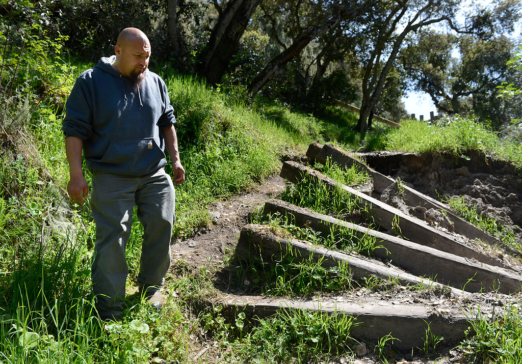 . Toro Park building and grounds supervisor Hector Campos walks past stairs damaged by this winter\'s storms on the Ollason Trail at the park in rural Salinas on Thursday March 16, 2017. Campos said the trail is restricted to hikers but mountain bikers frequently use it. Campos said that currently 97% of the trails are closed due to erosion, downed trees and other storm damage.  (David Royal - Monterey Herald)