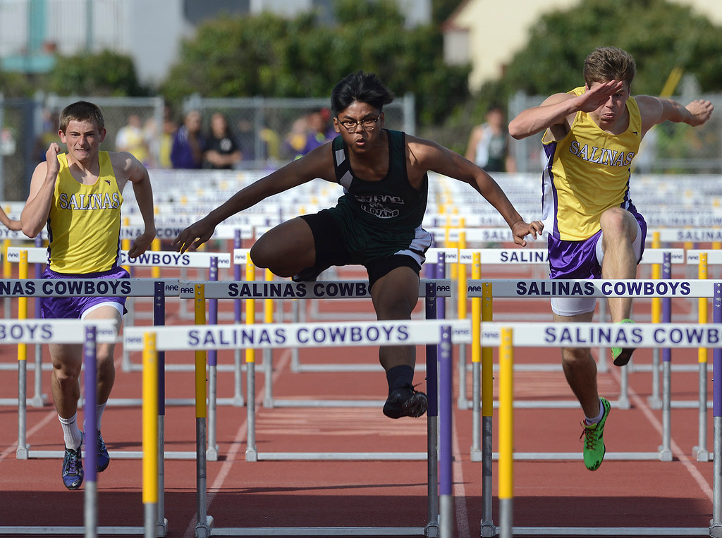 . Alisal\'s Rex Tomimbang, center, races to a win in the boys 110 meter high hurdles in front of Salinas\' Jonathan Chagnon, left, and Brett Reade during a track meet against Alisal at Salinas High School on Thursday March 16, 2017. Tomimbang finished 16:64, Reade was second at 16:06 and Chagnon was third at 16:64.  (David Royal - Monterey Herald)