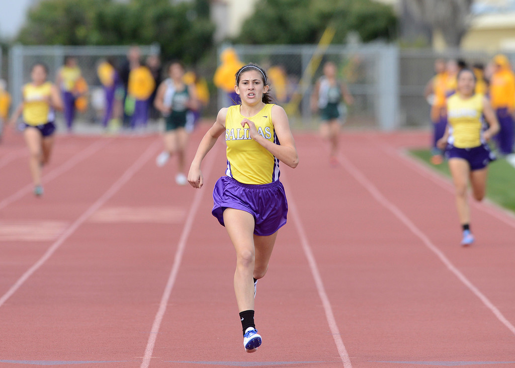 . Salinas\' Brooke Oleson races ahead of competitors on the final stretch of the girls 400 meter race during a track meet against Alisal at Salinas High School on Thursday March 16, 2017. Oleson\'s winning time was 59:59.  (David Royal - Monterey Herald)