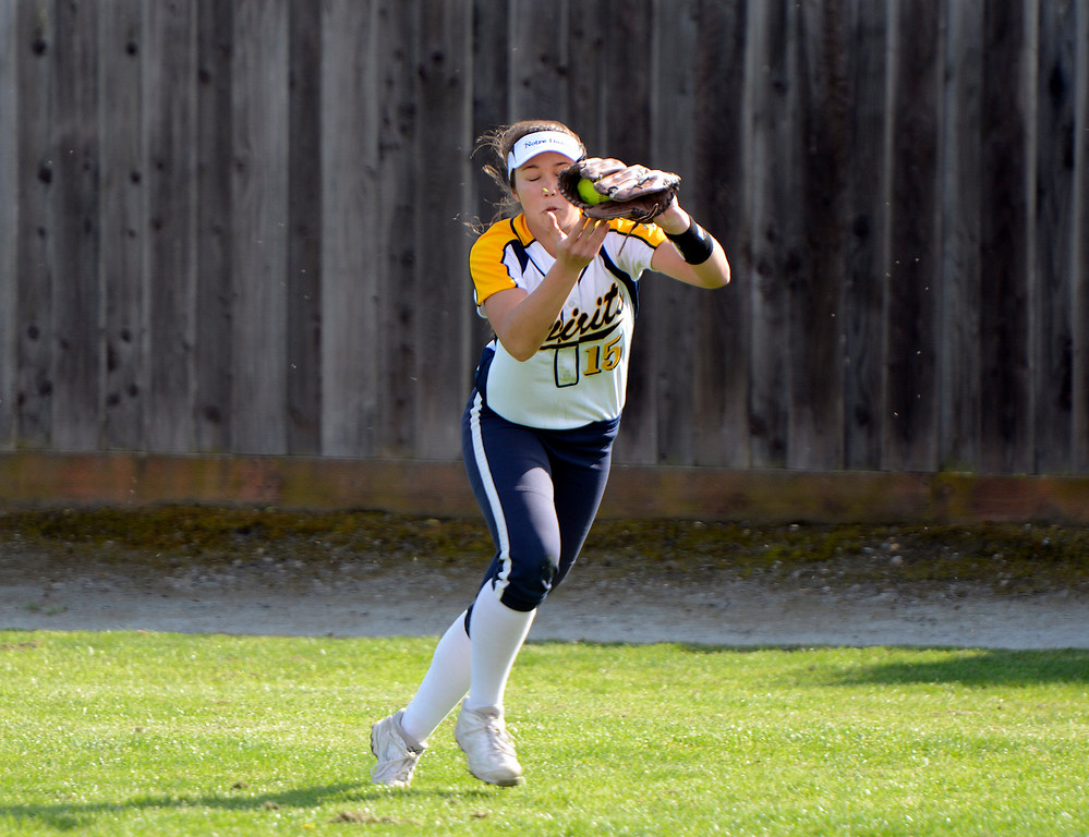 . Notre Dame\'s Logan Riggenbach reels in a fly ball during softball against Santa Teresa at Notre Dame High School in Salinas on Wednesday March 15, 2017. (David Royal - Monterey Herald)