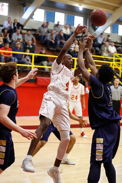 . Palma\'s Jamaree Bouyea (4) passes the ball over Central Catholic\'s Malcolm Clayton (15) during a boys basketball NorCal Division IV Regional Semifinals game at Palma High School on Tuesday, Mar. 14, 2017 in Salinas, Calif. (Vernon McKnight/Herald Correspondent)