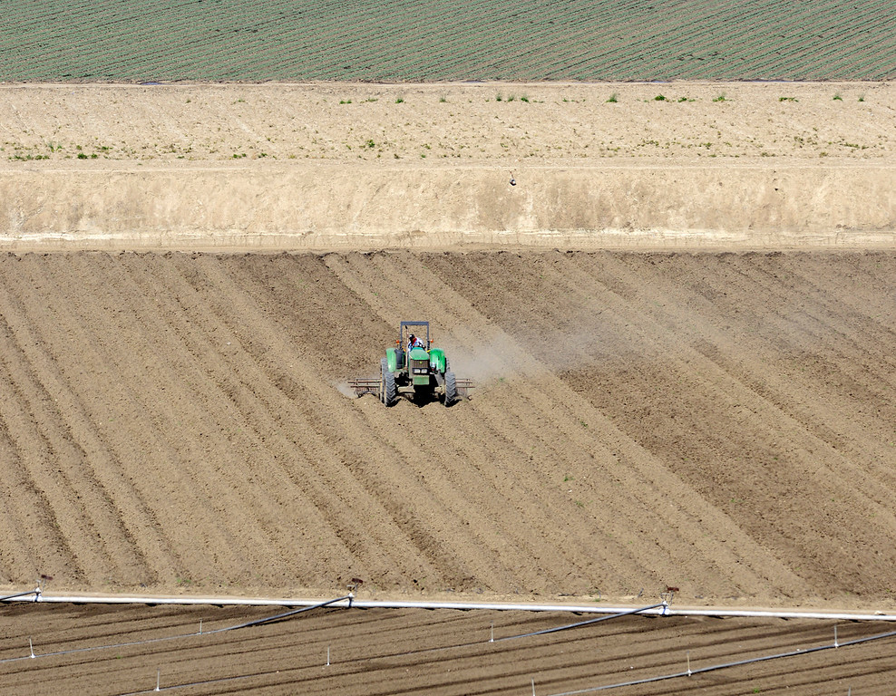 . A farmer readies land for planting in a patchwork of fields in rural Salinas on Thursday March 16, 2017. (David Royal - Monterey Herald)