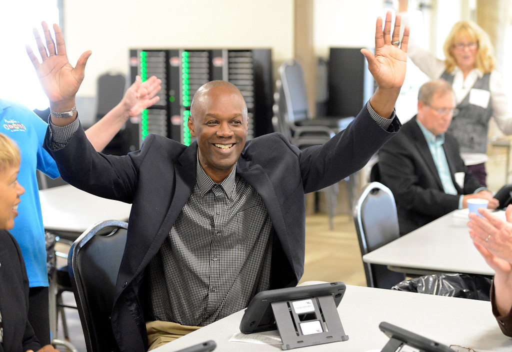 . Boy\'s & Girls Club of Monterey County associate vice president Ron Johnson raises his arms in the air after winning a bingo game during the unveiling of the new Pacific Bingo at the Monterey Fair and Events Center on Friday March 10, 2017. (David Royal - Monterey Herald)