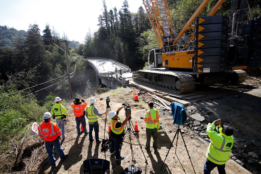 . Members of the media watch as crews were making progress on the demolition of the storm damaged Pfeiffer Canyon Bridge in Big Sur on Thursday, March 16, 2017.  (Vern Fisher - Monterey Herald)