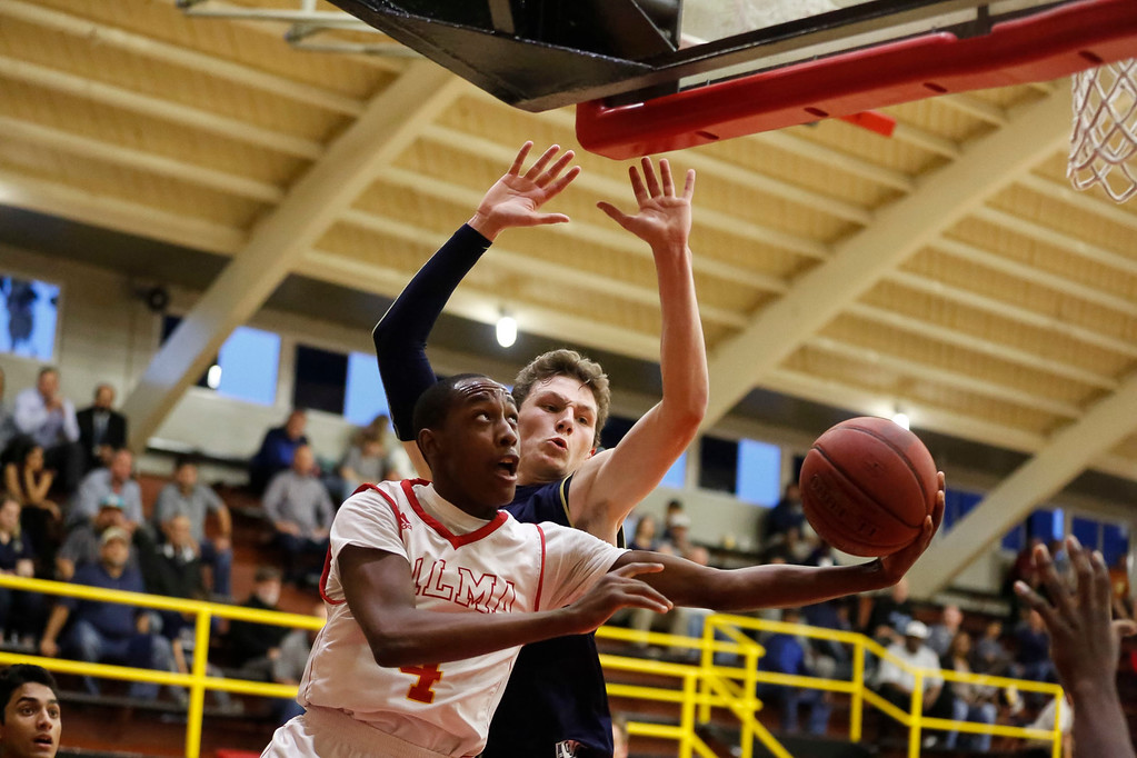 . Palma\'s Jamaree Bouyea (4) drives to the basket against Central Catholic\'s Conor Fenton (11) during a boys basketball NorCal Division IV Regional Semifinals game at Palma High School on Tuesday, Mar. 14, 2017 in Salinas, Calif. (Vernon McKnight/Herald Correspondent)