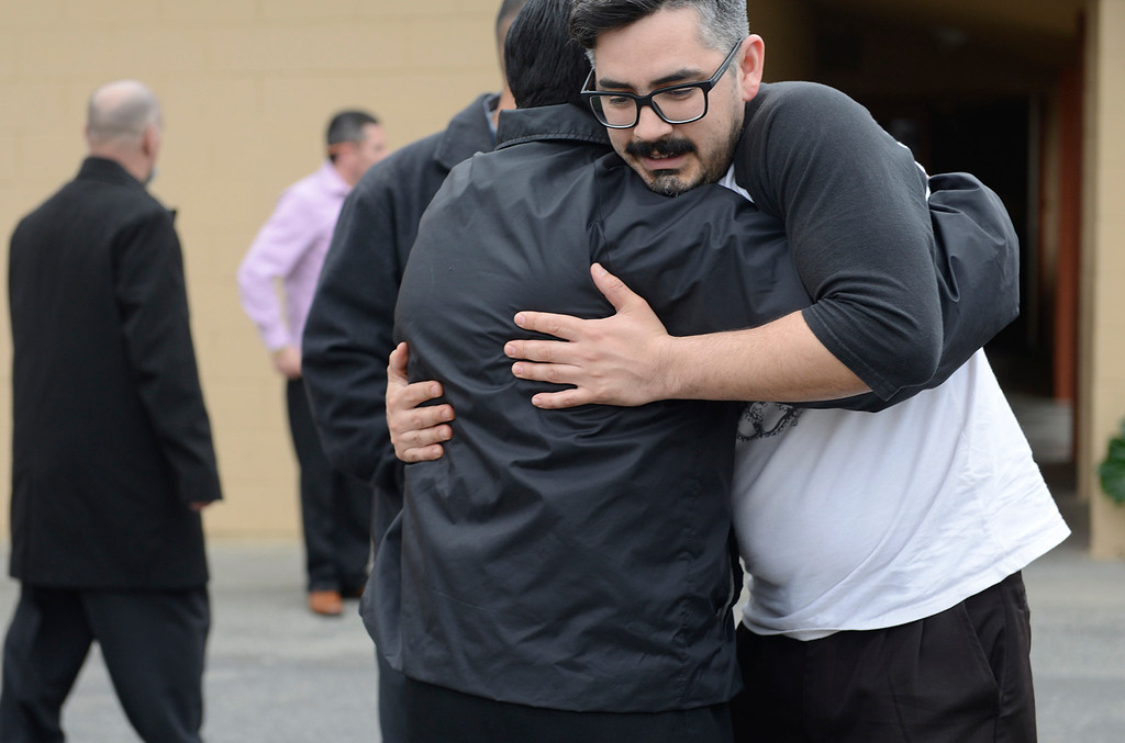 . Mike Perez hugs Pastor Jerry Morales during a gathering for Pastor Herbert Valero at Victory Outreach Church in Salinas on Wednesday March 15, 2017. Valero was stabbed in the neck outside of his home after a going out to pray with a parishioner on Tuesday evening.  (David Royal - Monterey Herald)