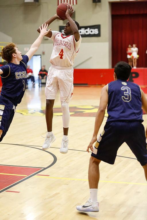 . Palma\'s Jamaree Bouyea (4) shots the ball over Central Catholic\'s Jarred Rice (1) during a boys basketball NorCal Division IV Regional Semifinals game at Palma High School on Tuesday, Mar. 14, 2017 in Salinas, Calif. (Vernon McKnight/Herald Correspondent)