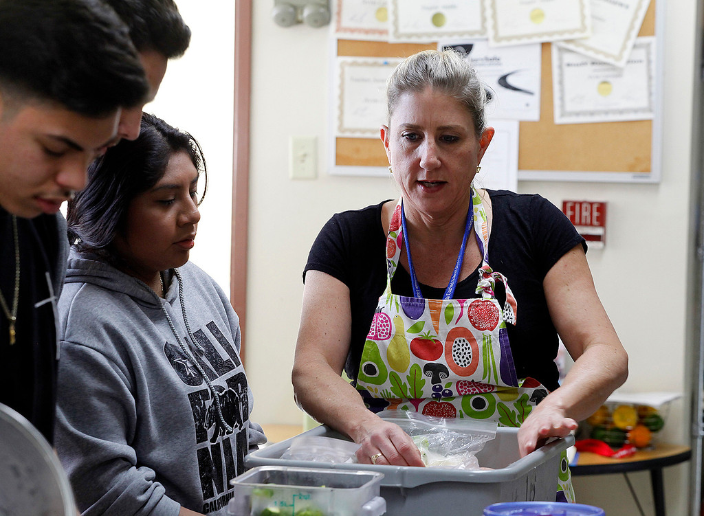 . Chef Kari Bernardi works with Central Coast High School students in their culinary academy kitchen in Seaside on Wednesday, March 15, 2017.  (Vern Fisher - Monterey Herald)