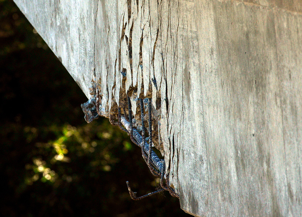 . Cracks grow on the east side of Pfeiffer Canyon Bridge on Highway 1 as construction crews use a wrecking ball to dismantle the structure in Big Sur, Calif. on Monday March 13, 2017. The bridge was compromised after slides occurred in the area associated with this winter\'s heavy rains.  (David Royal - Monterey Herald)