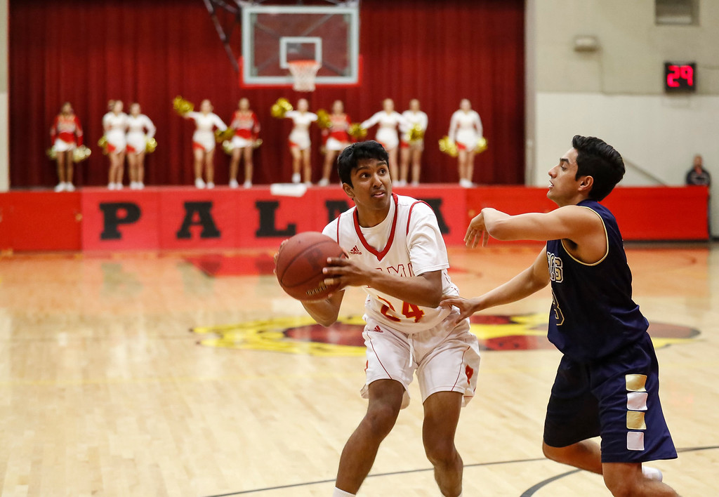 . Palma\'s Nikhil Manimaran (24) pulls up to shoot a jumper over Central Catholic\'s Amrit Dhaliwal (3) during a boys basketball NorCal Division IV Regional Semifinals game at Palma High School on Tuesday, Mar. 14, 2017 in Salinas, Calif. (Vernon McKnight/Herald Correspondent)