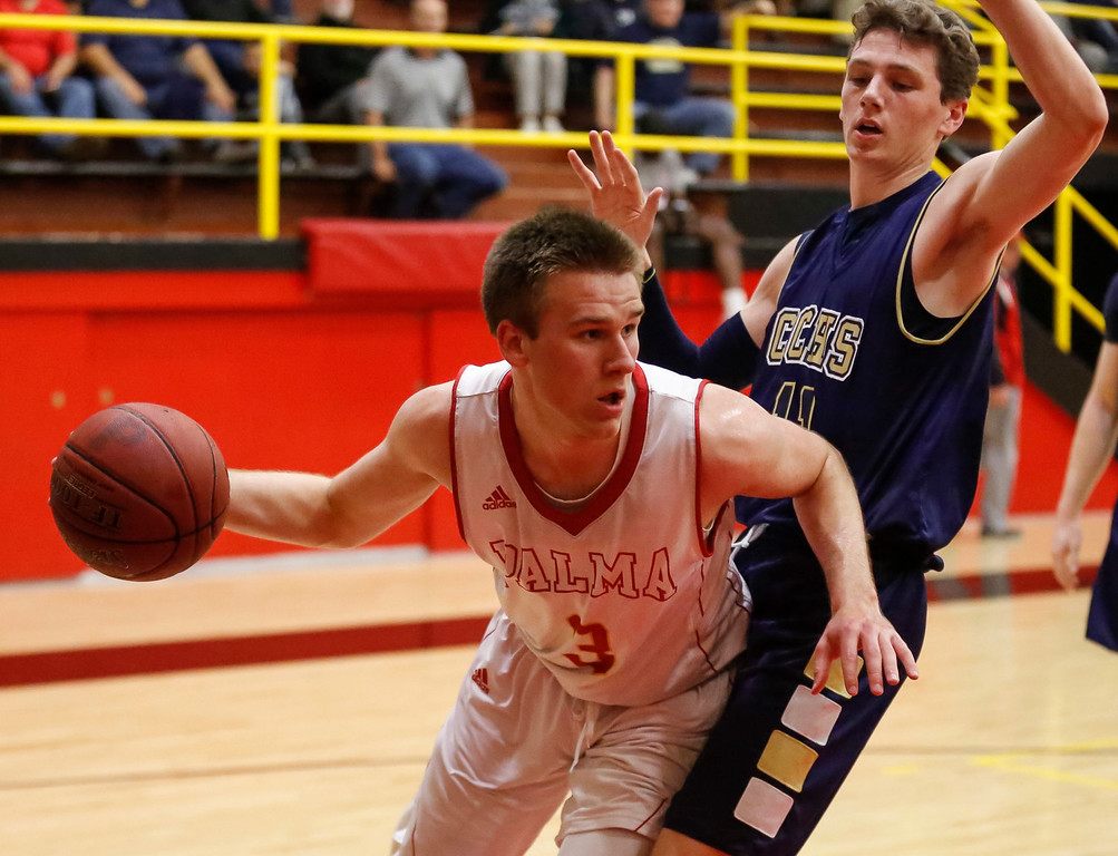. Palma\'s Garrett Maker (3) looks to pass the ball against Central Catholic\'s Conor Fenton (11) during a boys basketball NorCal Division IV Regional Semifinals game at Palma High School on Tuesday, Mar. 14, 2017 in Salinas, Calif. (Vernon McKnight/Herald Correspondent)