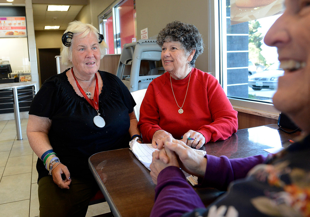 . Homeless person Juliette LeBlanc (left) gets assistance from Judy Peiken and Lois Varner at the Burger King in Seaside on Monday, March 19, 2018.  (Vern Fisher - Monterey Herald)