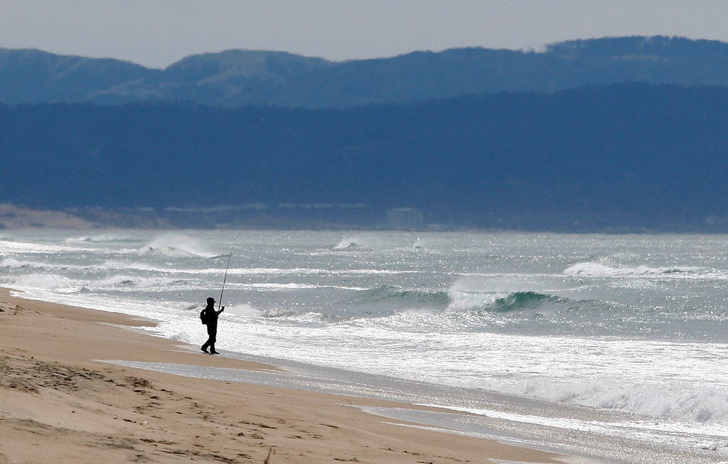 . A surf fisherman at Salinas River State Beach on Monday, March 19, 2018.  (Vern Fisher - Monterey Herald)