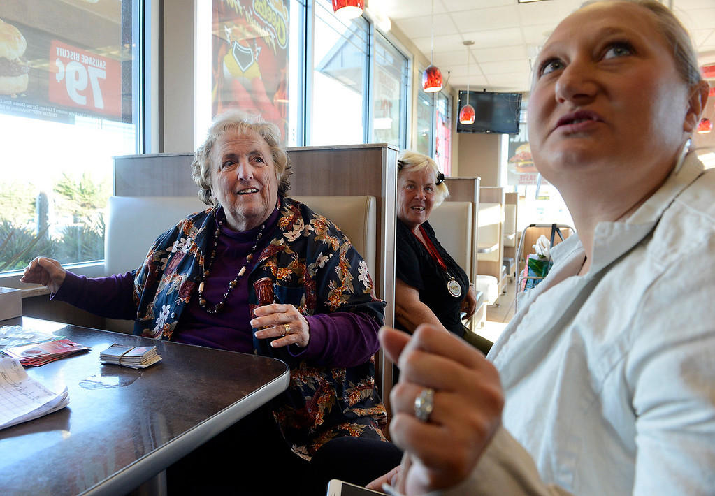 . Lois Varner along with Sadie Kvenild help homeless women at the Burger King in Seaside on Monday, March 19, 2018.  (Vern Fisher - Monterey Herald)