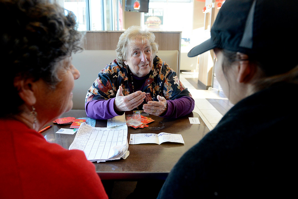 . Lois Varner meeting with homeless women offering them assistance at the Seaside Burger King on Monday, March 19, 2018.  (Vern Fisher - Monterey Herald)