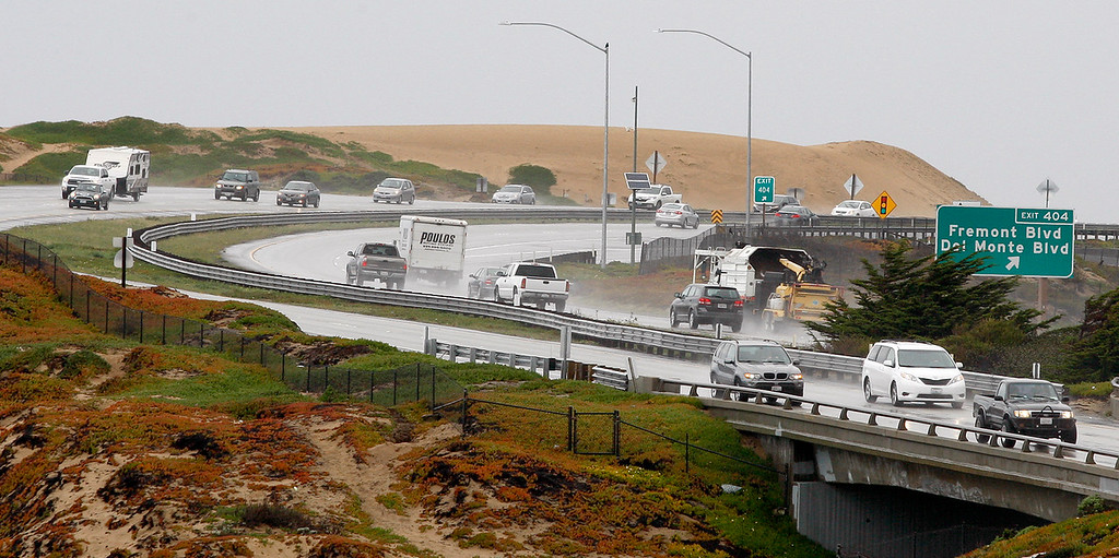 . Motorists dealing with standing water from the heavy rain on Highway One in Seaside on Friday, March 16, 2018.  (Vern Fisher - Monterey Herald)