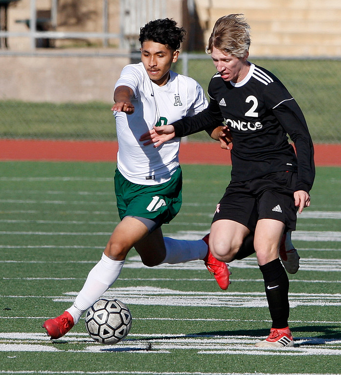 . Alisal High School\'s Juan Moya (10) battles Bella Vista High School\'s Gabriel Alderman (2) during their CIF Nor Cal semifinals soccer match in Salinas on Thursday, March 8, 2018.  .  (Vern Fisher - Monterey Herald)
