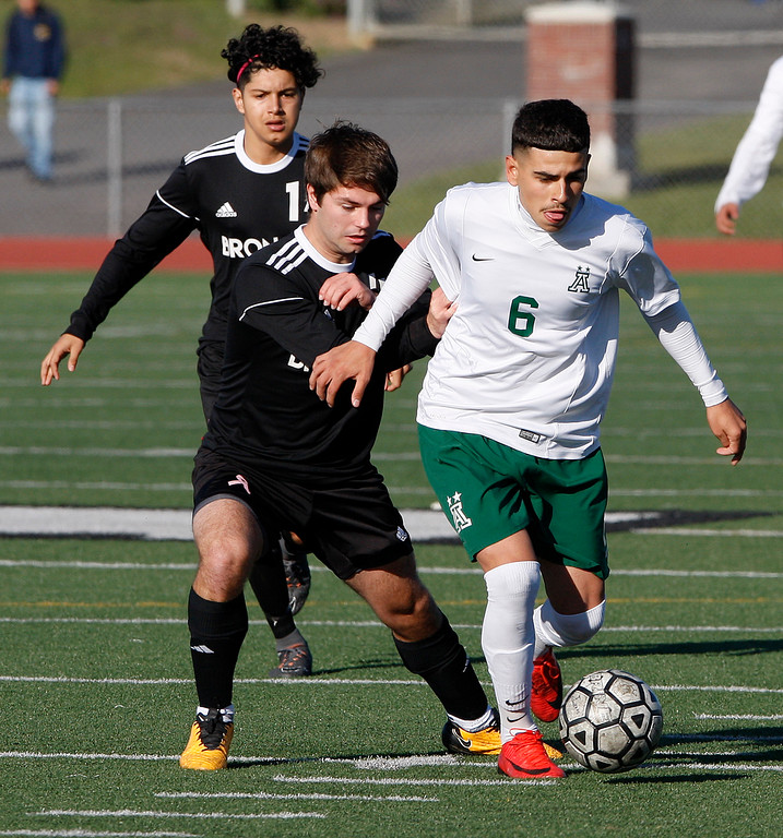 . Bella Vista High School\'s Andrew Lauritzen (4) battles Alisal High School\'s Angel Amezcua (6) during their CIF Nor Cal semifinals soccer match against Bella Vista High School in Salinas on Thursday, March 8, 2018.  .  (Vern Fisher - Monterey Herald)