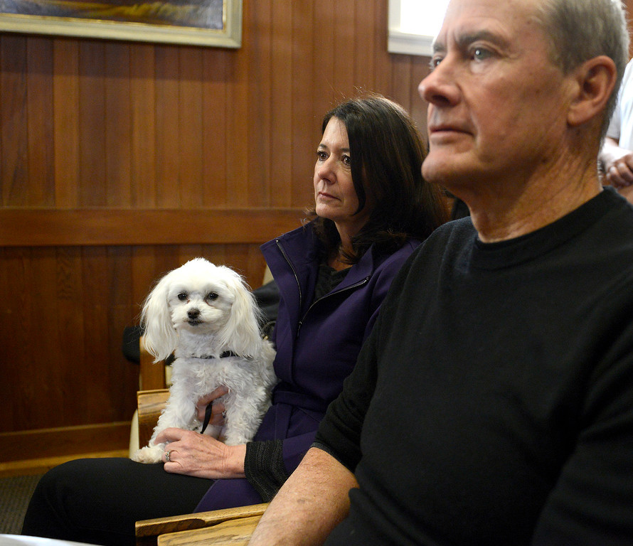 . Carmel residents Donna Gary and Rob Wallace attend with their dog Bailey the Steve Dallas investigation press conference in city council chambers on Wednesday, March 7, 2018.  (Vern Fisher - Monterey Herald)
