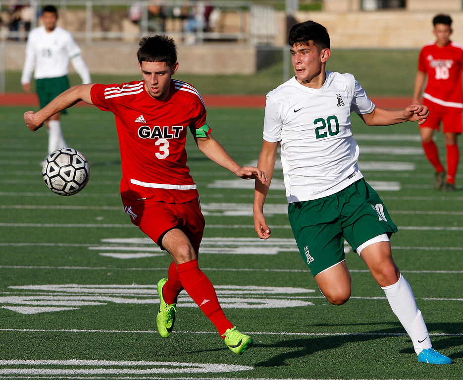 . Galt High School\'s Hector Serrato (3) battles Alisal High School\'s Abraham Montano (20) during their CIF Nor Cal soccer match in Salinas on Tuesday, March 6, 2018.  Alisal High beat Galt High 3-2 to advance to the Nor Cal semifinals.  (Vern Fisher - Monterey Herald)