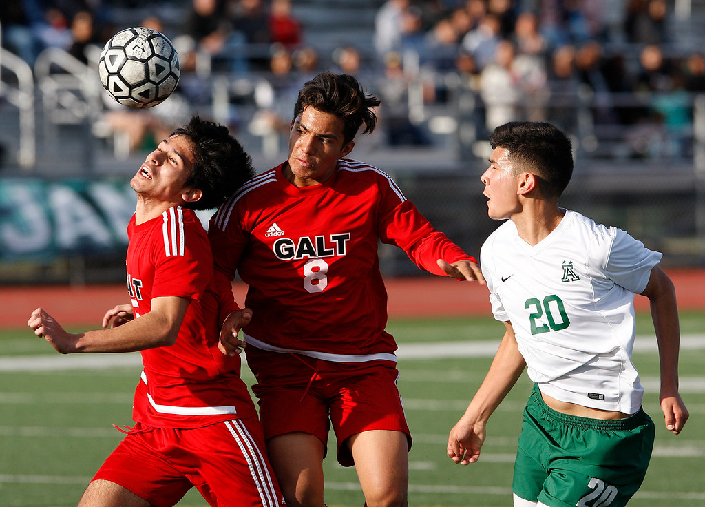 . Galt High School\'s Jose Alvarez (5) and Orlando Villalobos (8) keep the ball away from Alisal High School\'s Abraham Montano (20) during their CIF Nor Cal soccer match in Salinas on Tuesday, March 6, 2018.  Alisal High beat Galt High 3-2 to advance to the Nor Cal semifinals.  (Vern Fisher - Monterey Herald)