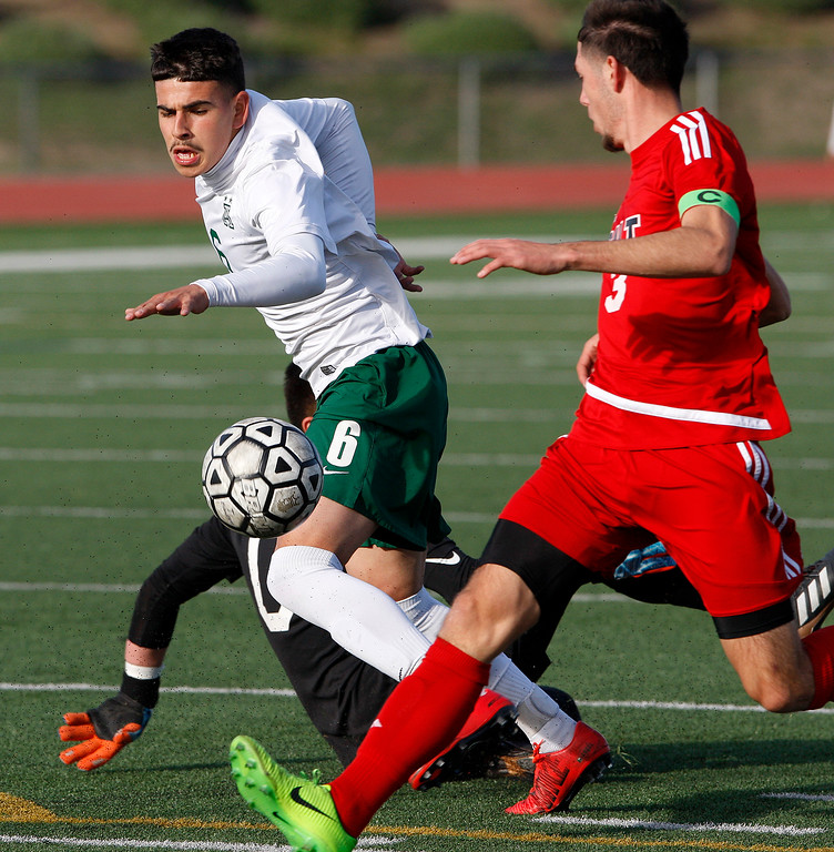 . Alisal High School\'s Angel Amezcua (6) gets by Galt High School\'s Hector Serrato (3) during their CIF Nor Cal soccer match in Salinas on Tuesday, March 6, 2018.  Alisal High beat Galt High 3-2 to advance to the Nor Cal semifinals.  (Vern Fisher - Monterey Herald)
