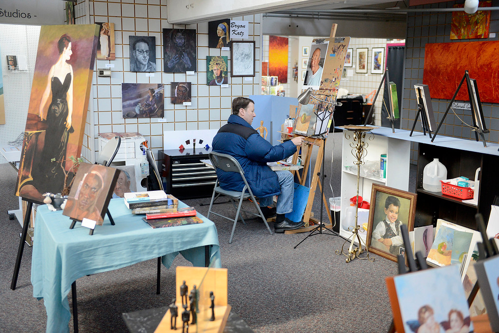 . Artist Bryan Katz in his studio space at ArtWorks in the American Tin Cannery in Pacific Grove on Friday, March 2, 2018.  (Vern Fisher - Monterey Herald)