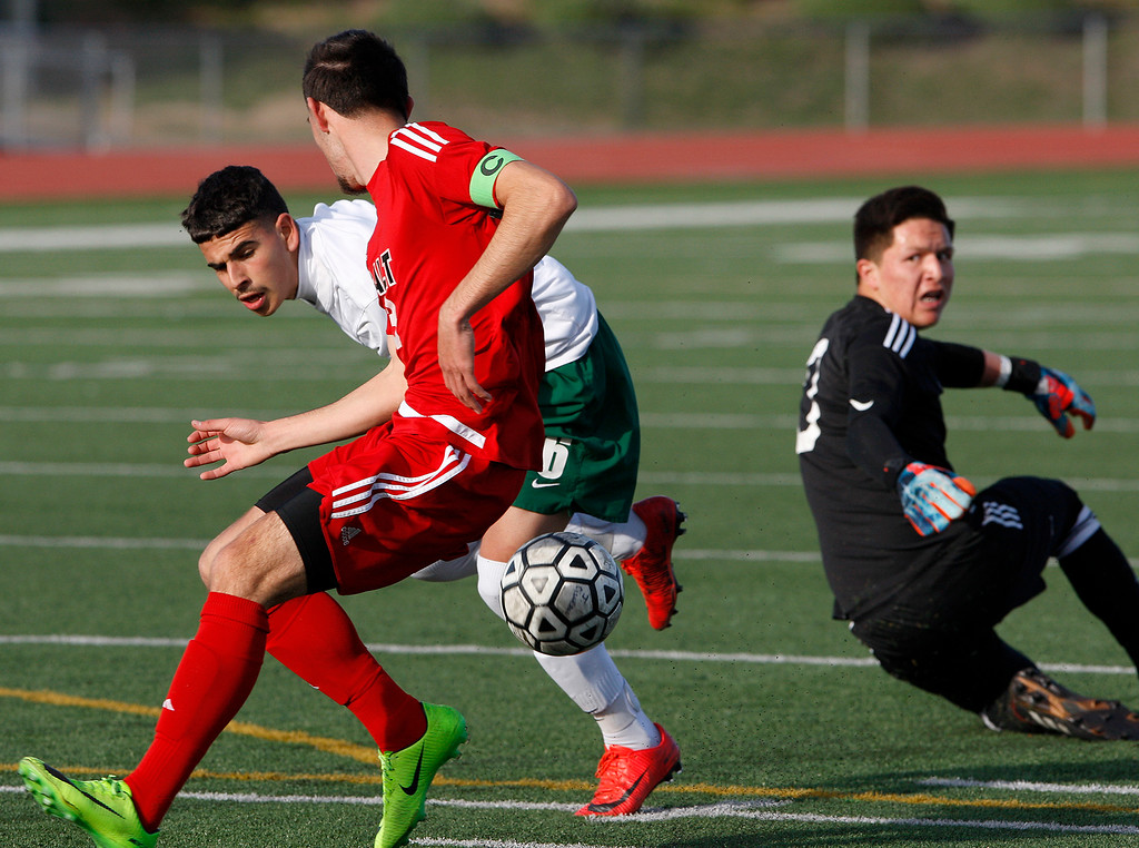 . Alisal High School\'s Angel Amezcua (6) gets by Galt High School\'s goalie Maico Ortiz (0) and defender Hector Serrato (3) during their CIF Nor Cal soccer match in Salinas on Tuesday, March 6, 2018.  Alisal High beat Galt High 3-2 to advance to the Nor Cal semifinals.  (Vern Fisher - Monterey Herald)
