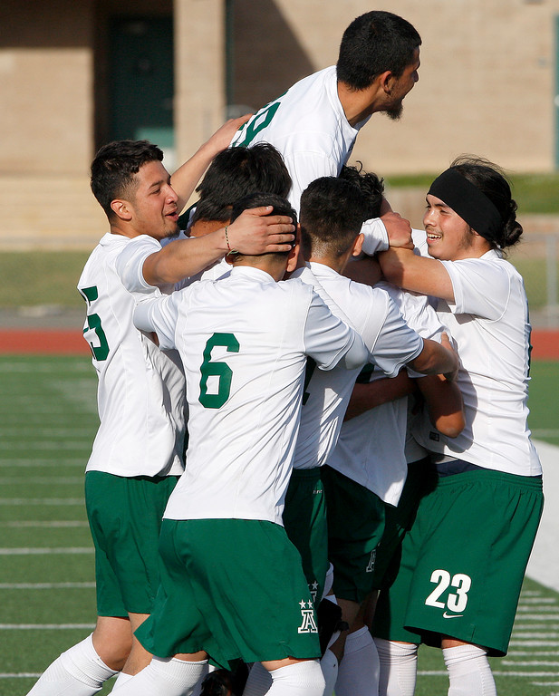 . Alisal High School players celebrate a first half goal against Galt High School during their CIF Nor Cal soccer match in Salinas on Tuesday, March 6, 2018.  Alisal High beat Galt High 3-2 to advance to the Nor Cal semifinals.  (Vern Fisher - Monterey Herald)
