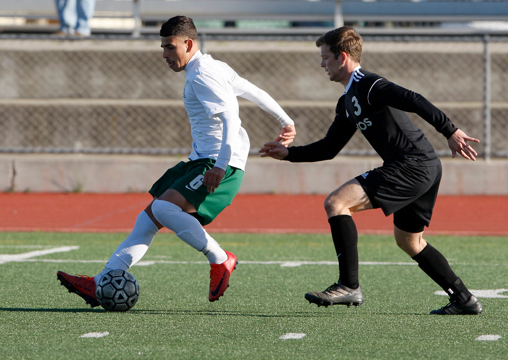 . Alisal High School\'s Angel Amezcua (6) battles Bella Vista High School\'s Kevin Williams (3) during their CIF Nor Cal semifinals soccer match in Salinas on Thursday, March 8, 2018.  .  (Vern Fisher - Monterey Herald)