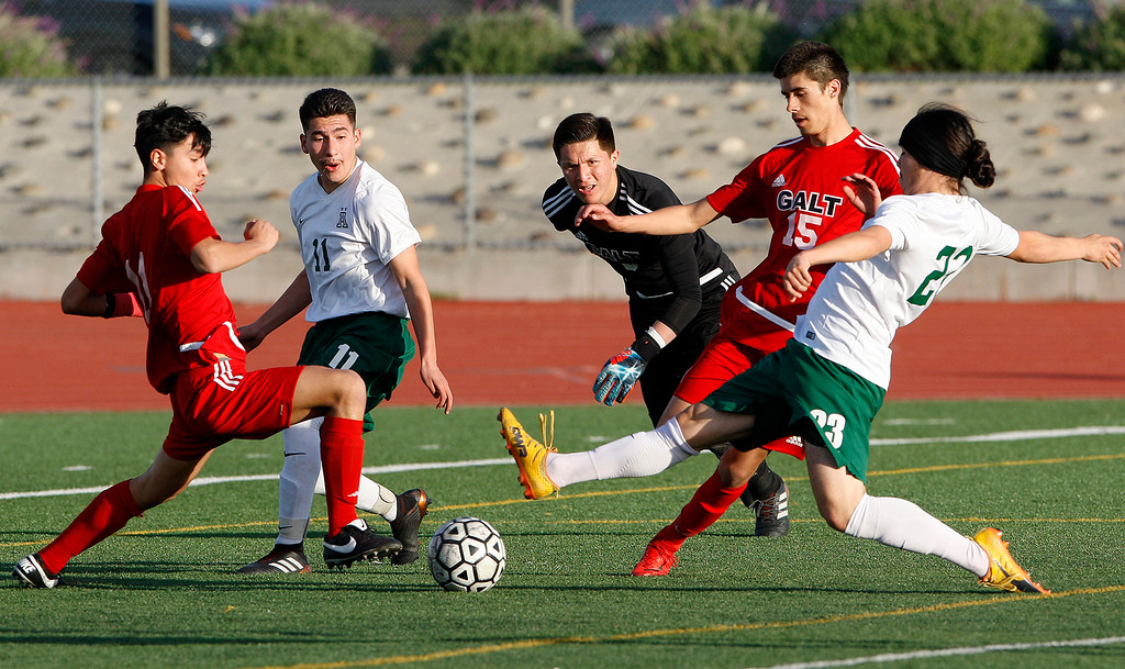 . Alisal High School\'s Carlos Pacheco (23) makes a shot on goal against Galt High School during their CIF Nor Cal soccer match in Salinas on Tuesday, March 6, 2018.  Alisal High beat Galt High 3-2 to advance to the Nor Cal semifinals.  (Vern Fisher - Monterey Herald)