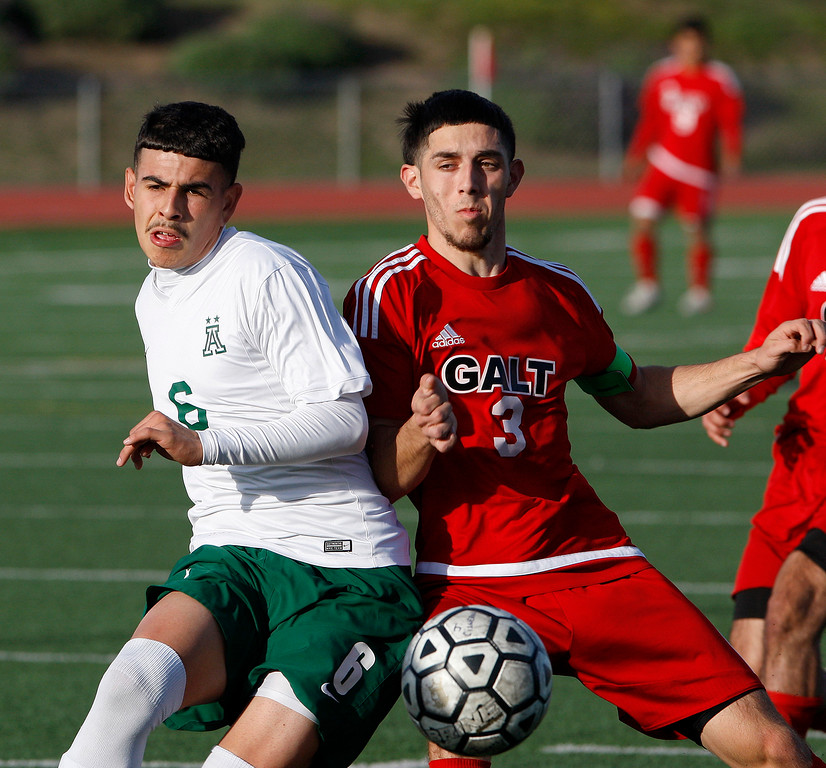 . Alisal High School\'s Angel Amezcua (6) battles Galt High School\'s Hector Serrato (3) during their CIF Nor Cal soccer match in Salinas on Tuesday, March 6, 2018.  Alisal High beat Galt High 3-2 to advance to the Nor Cal semifinals.  (Vern Fisher - Monterey Herald)