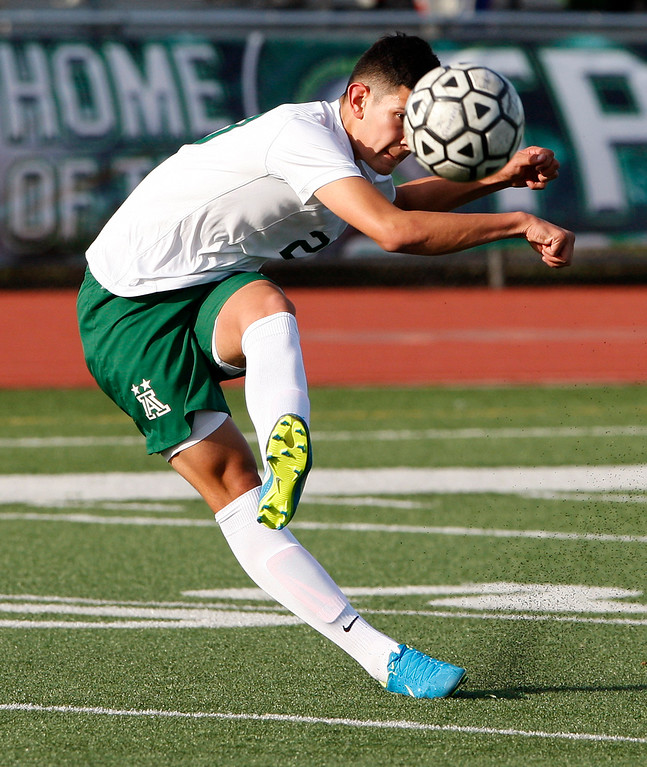 . Alisal High School\'s Abraham Montano (20) takes a shot on goal during their CIF Nor Cal soccer match against Galt High School in Salinas on Tuesday, March 6, 2018.  Alisal High beat Galt High 3-2 to advance to the Nor Cal semifinals.  (Vern Fisher - Monterey Herald)