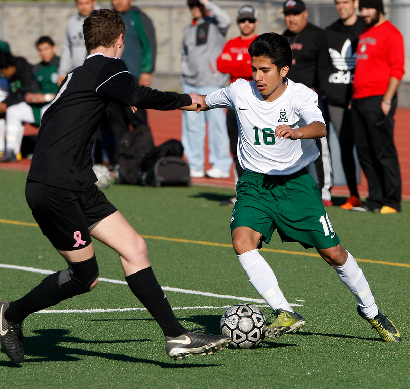 . Bella Vista High School\'s Kody Fruits (6) battles Alisal High School\'s Orlando Juarez (16) during their CIF Nor Cal semifinals soccer match in Salinas on Thursday, March 8, 2018.  .  (Vern Fisher - Monterey Herald)