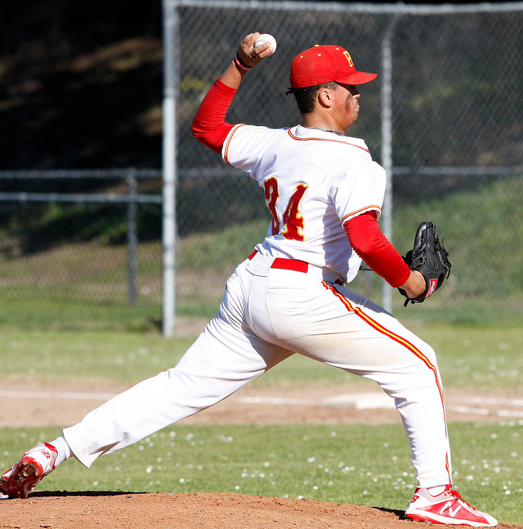 . Pacific Grove High\'s Kevahn Ebron (34) delivers a pitch in the second inning during their game against Greenfield High on Wednesday, March 7, 2018.  (Vern Fisher - Monterey Herald)