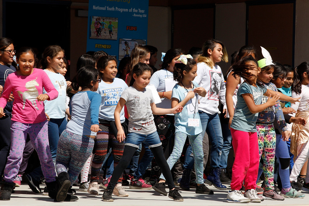 . Students from Santa Rita Elementary School in Salinas celebrate the �4 Million Miles� Just Run program milestone on Friday, March 23, 2018.  (Vern Fisher - Monterey Herald)