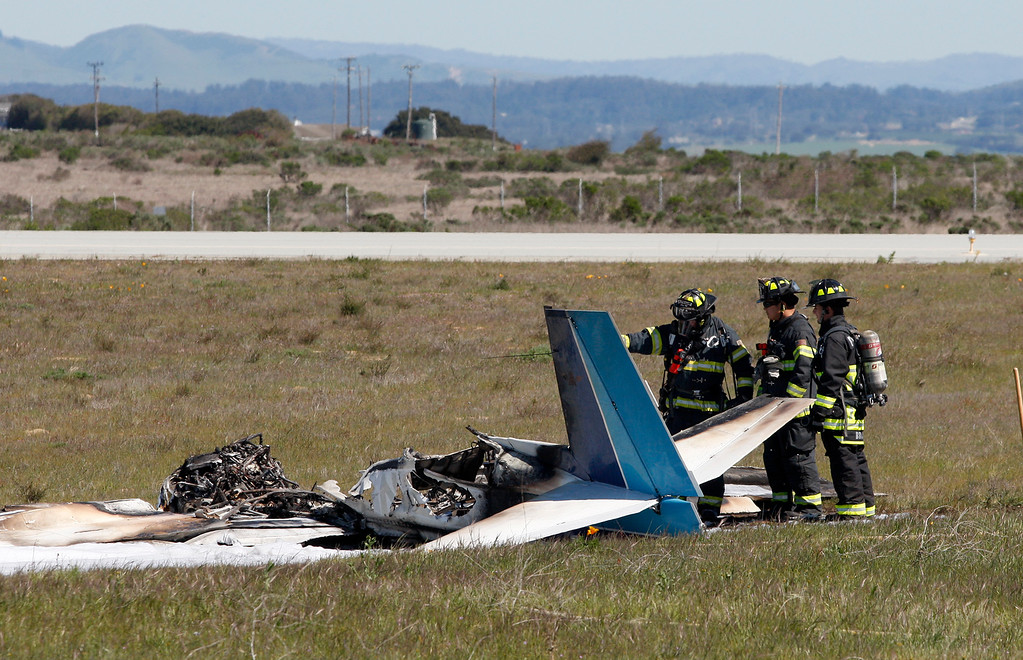. Marina fire and police personnel on scene at the Marina Airport of a single engine plane crash and fire that resulted in one fatality on Monday, March 26, 2018.  (Vern Fisher - Monterey Herald)